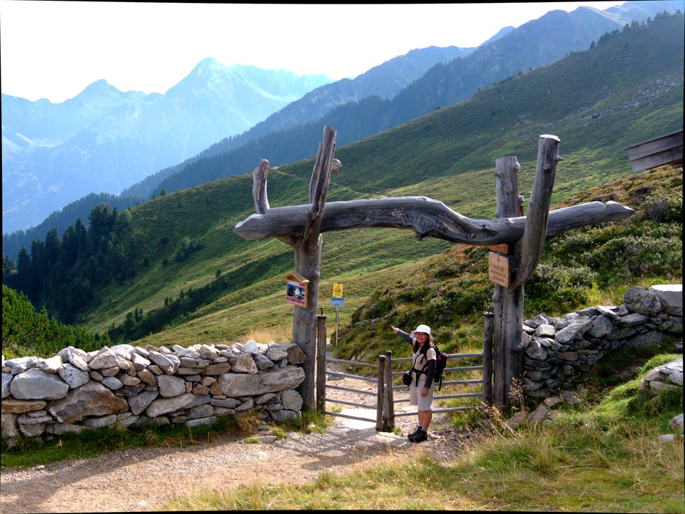 The path heads through a massive log gateway to the Edelhutte, and then on to the Ahornspitze
