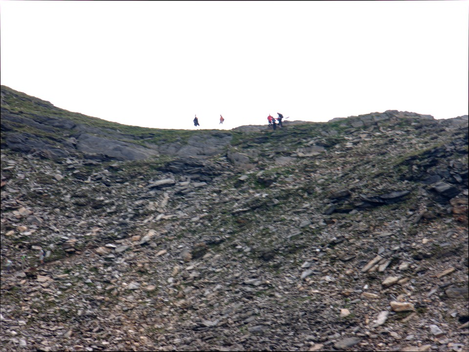 The final ascent to the ridge is lose scree