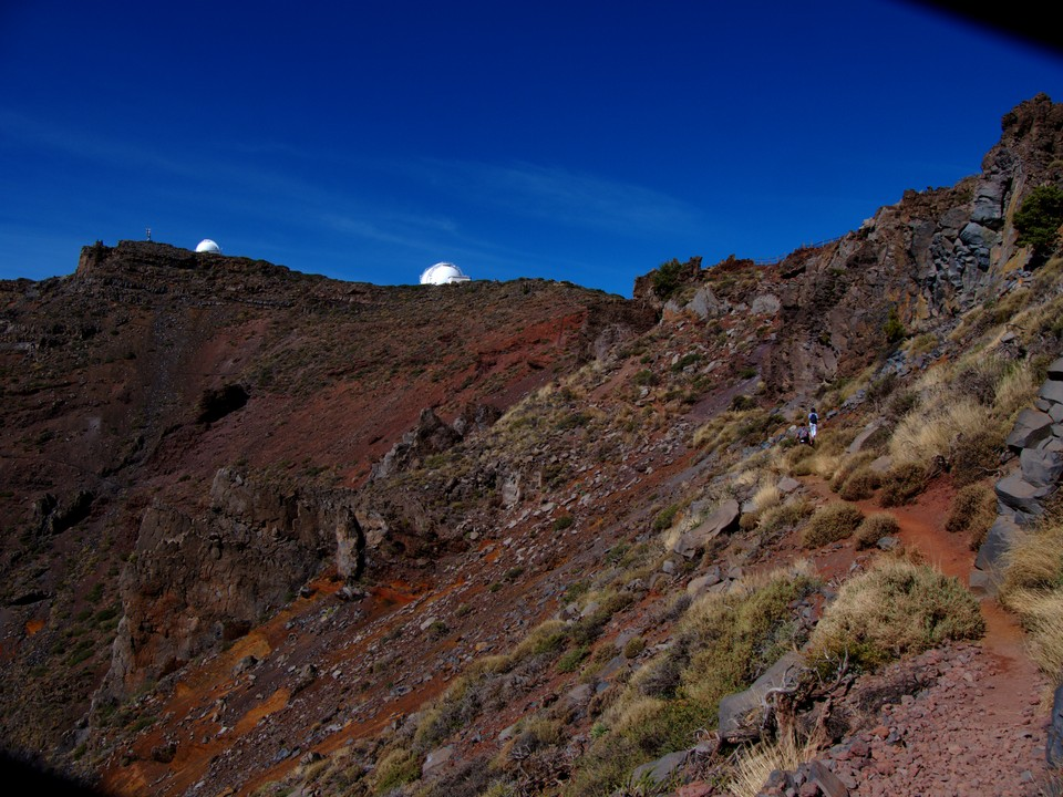 The protecting domes over the big telescopes that sit just over the ridge.