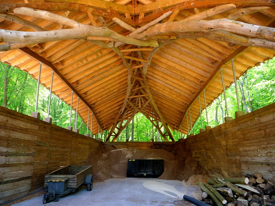 Natural round timber forming a double arch