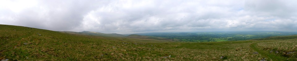 View from the west side of Corn Ridge on a slightly misty morning, with Great Links Tor on the left and Sourton Tors to the right. The villages of Lydford and Bridestow in the middle distance.