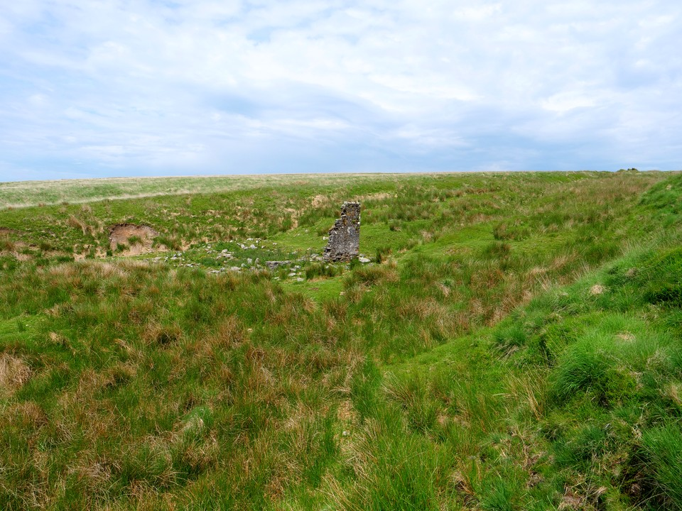 At Petre's Pits Bottom are the remains of a substantial building