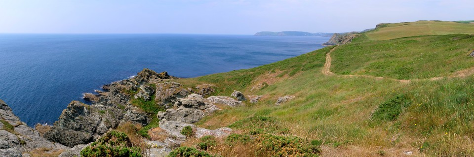 Panorama west of south west coast path from the lookout point at East Prawle