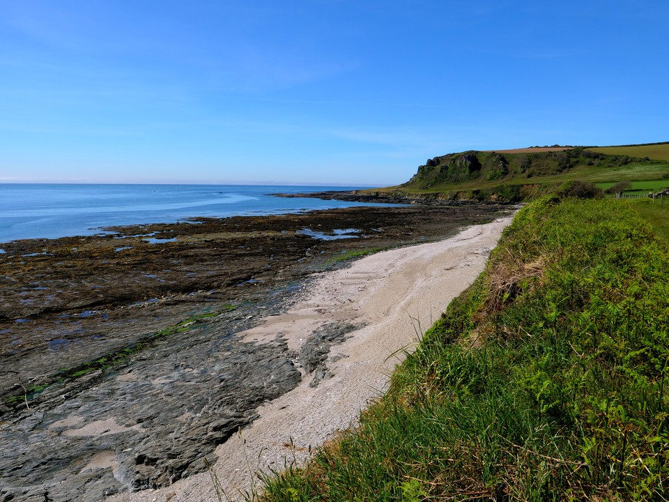 The beach below Maelcombe House has many rock pools to explore at low tide