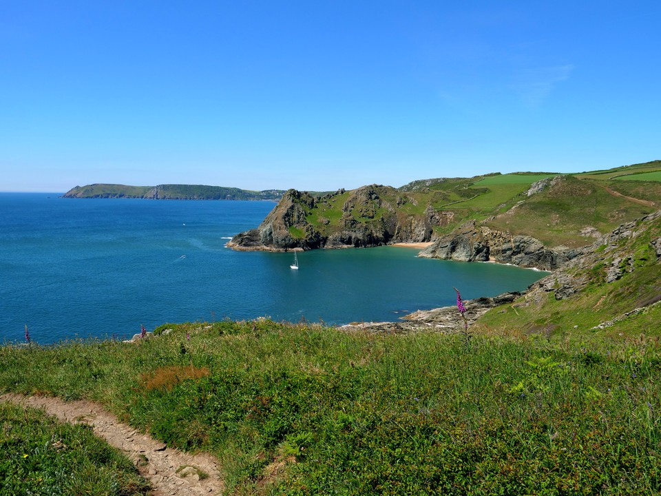 Macely Cove is a popular spot with a sandy beach, but a steep path down.