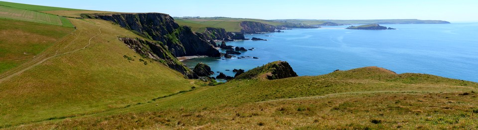 panorama of the South West Coast Path looking towards Ayrmer Cove, Burgh Island and Bolt Tail
