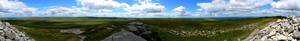 A Dartmoor Panorama from High WillHays. The Princetown mast, almost due South is in the middle. Yes Tor, almost due North on the right. On the left you can see East Okement Farm and Cosdon Hill