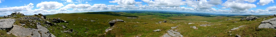 Dartmoor Panorama from the western edge of Yes Tor. - the top was too busy!  Extreme left, and east in this shot. The big circle of stones is west. To the right of that you can see the Meldon viaduct. I descended almsot due north from here, picking my way between the big patches of very large clitter down to the track you can see crossing Red-a-ven brook.