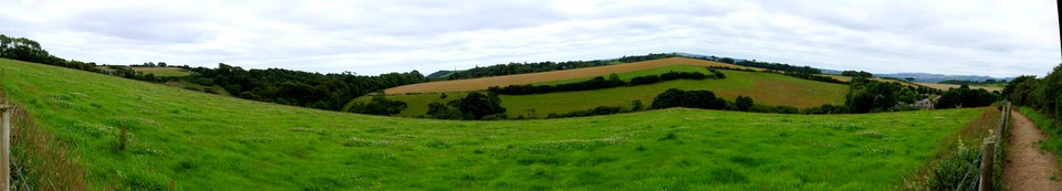 Panorama: the view from the Saint's Way near Trenant. Gribbin Tower in the middle horizon