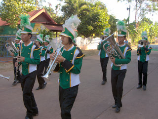 2012-12-28-02-56-20_p1090641_kumphawapi-school-procession.jpg  members of the band play their silver trumpets and tubas. A procession of costumes traditional and modern through Kumphawapi by the members of the School