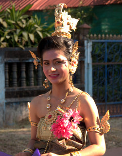 2012-12-28-03-01-20_p1090658_kumphawapi-school-procession.jpg  This young woman is wearing elaborate decoration of gold over her bare shoulders A procession of costumes traditional and modern through Kumphawapi by the members of the School