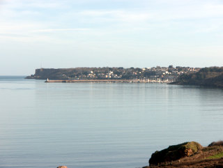 2013-02-15-14-22-11_p1100055_brixham-to-torquay-coast-path-8-miles.jpg  Brixham in the distance and its harbour wall