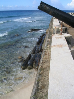 barbados-2004-nov-061.jpg  The old cannon form part of the breakwater.  make sure you have footware that you can keep on as you wade round the end. The rock is very sharp and you don't want bare feet!