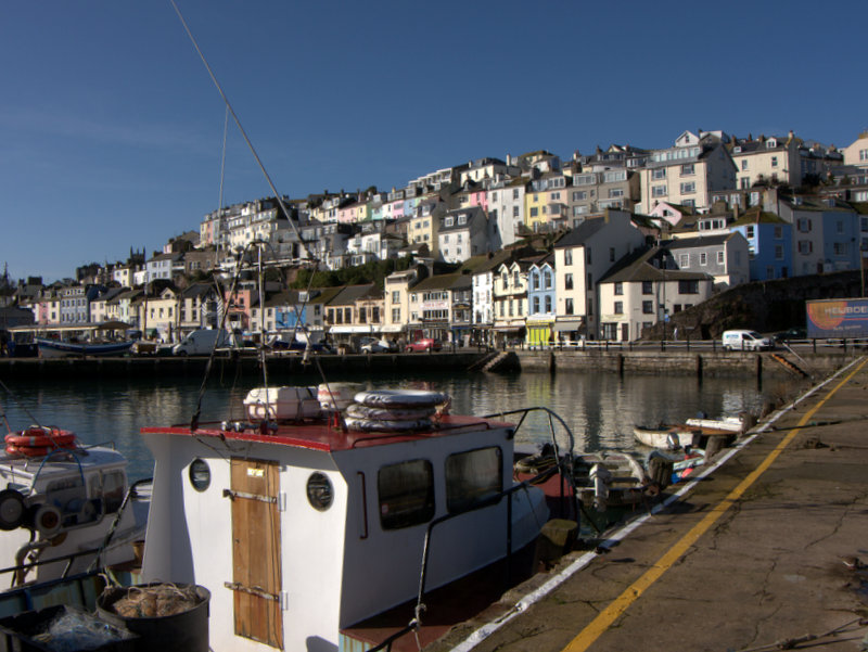 The Inner Harbour at Brixham  The Inner Harbour at Brixham at high tide, and the old colourful houses that overlook it